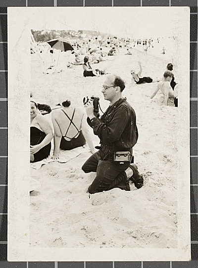 Samuel J. Woolf taking photographs at the beach