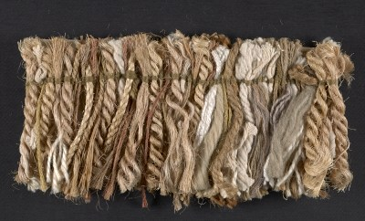 Fiber samples in natural, mauve, and gold