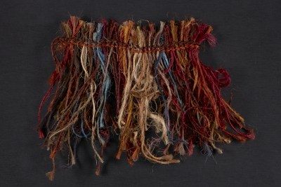 [Fiber samples in red, orange, and blue]