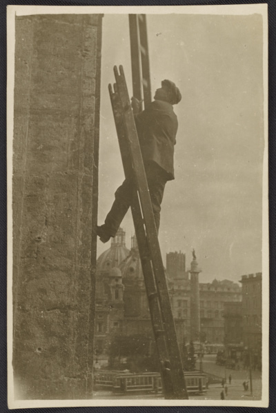 Unidentified man erecting ladders to measure architectural components of the San Marco Basilica in Rome