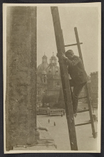 Unidentified man erecting ladders to measure and inspect architectural components of the San Marco Basilica in Rome