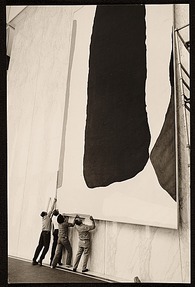[A crew installing Helen Frankenthaler's painting Guiding Red]