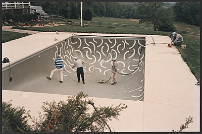 [Andre Emmerich watching David Hockney painting the interior of Emmerich's swimming pool]