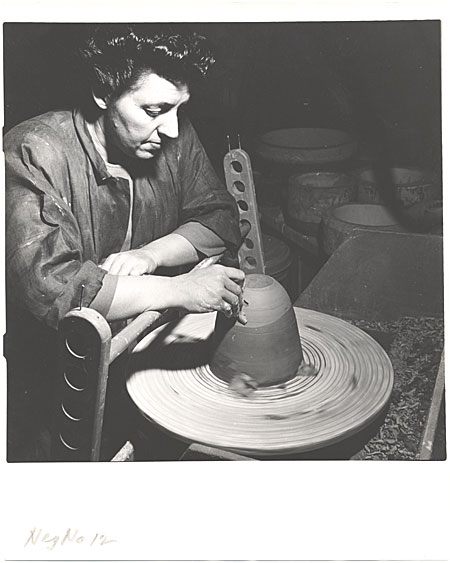 Laura Andreson at wheel trimming a pot