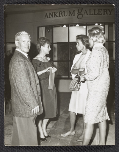 [Hans Burkhardt, Joan Ankrum, and two unidentified women at an art opening at Ankrum Gallery]
