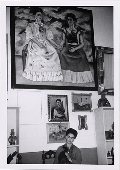 [Frida Kahlo in her studio with The Two Fridas, Coyoacán, Mexico]
