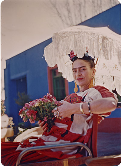 [Frida Kahlo on the patio of the Blue House]
