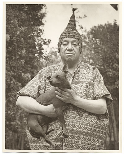 [Diego Rivera holding a dog.]