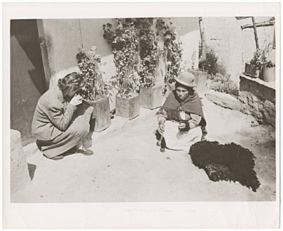 [Miss Florence Arquin taking picture of a Peruvian native]