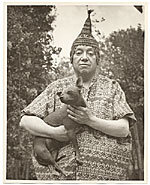 Diego Rivera holding a dog