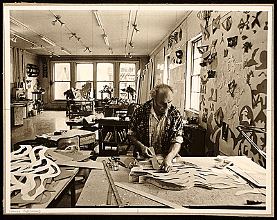 [George Sugarman at work in his studio]