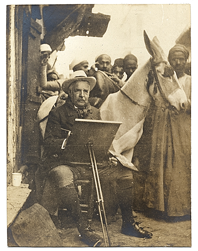 Henry Bacon at his easel in Egypt.