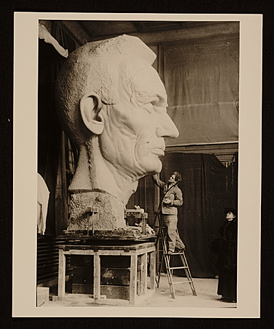 George Grey Barnard working on his sculpture Lincoln in thought