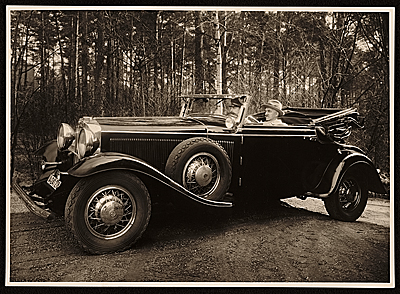 [Rudolf Bauer in his 1930 Graham-Paige automobile.]