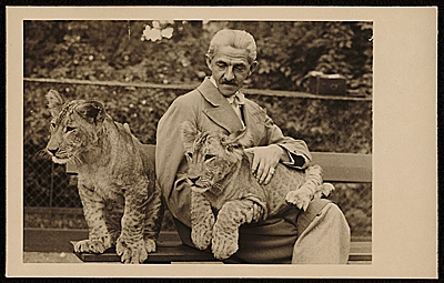 Rudolf Bauer seated with two lion cubs