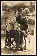 Rudolf Bauer seated with a lion cub