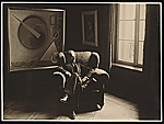 Rudolf Bauer seated in an armchair