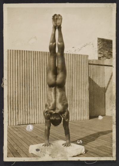 Artist's model Tony Sansone executing a handstand pose