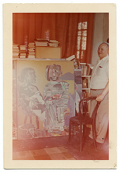 Romare Bearden with one of his paintings