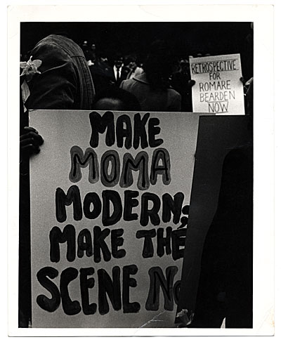 [Protest signs outside the Museum of Modern Art, New York, N.Y.]