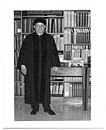Romare Bearden in academic robes standing in a library