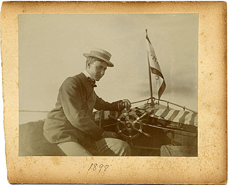 Gerrit Beneker at the helm of a sailboat