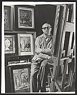 Eugene Berman with his works