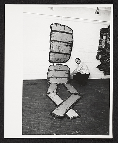 [Claes Oldenburg and one of his works in his show The Street at the Reuben Gallery]