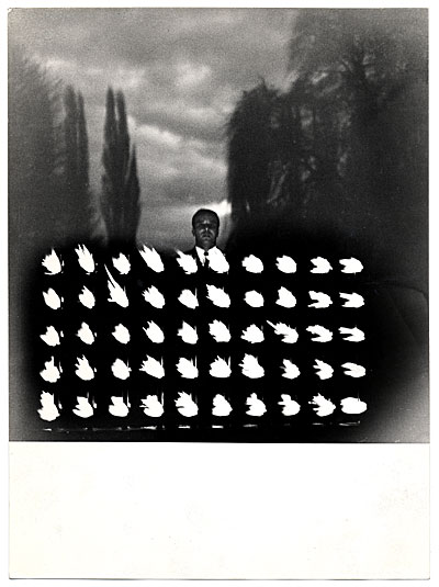 Yves Klein with his work Mur de feu (wall of fire)