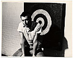 Jasper Johns with his work