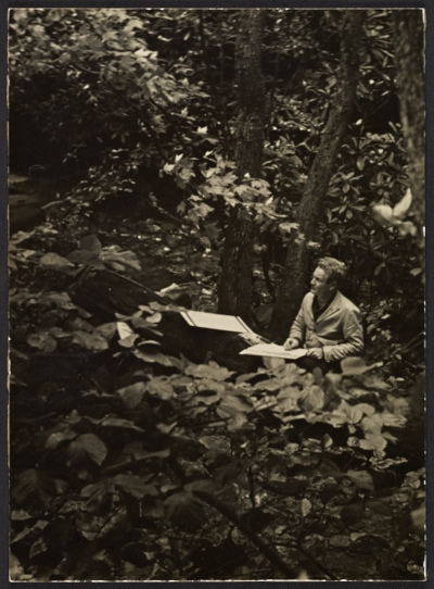 Peter Blume sketching in the woods