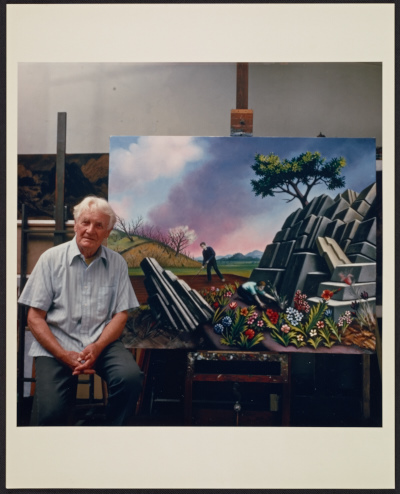 Peter Blume in his studio with his painting Spring