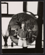 Peter Blume reflected in a mirror standing in front of his painting Tassos oak