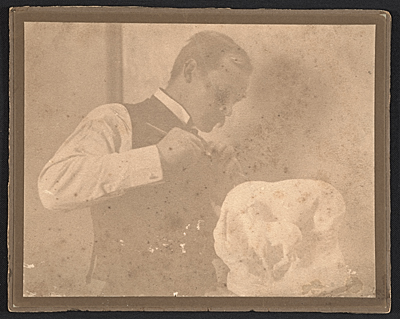 Solon Borglum working on his sculpture In the wind