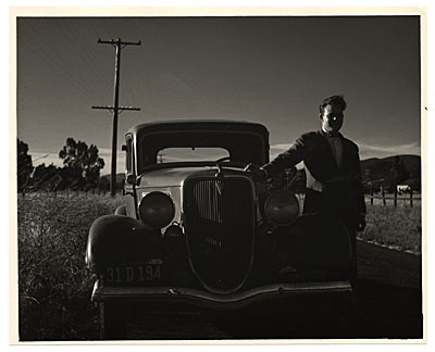 Harry Bowden standing next to a car