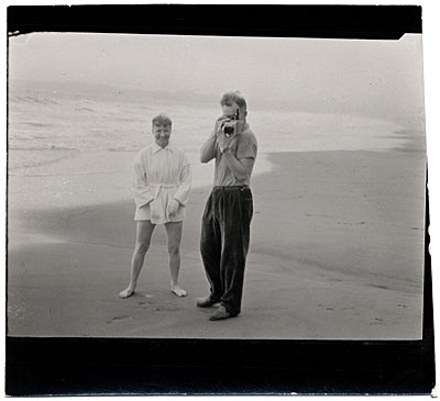 Harry Bowden taking a photograph on the beach