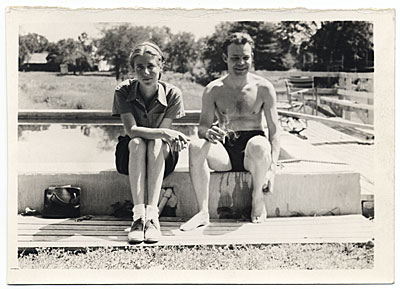 Harry Bowden sitting by a pool