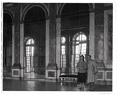 [Al and Frances Bernstein in the Hall of Mirrors at Versailles.]