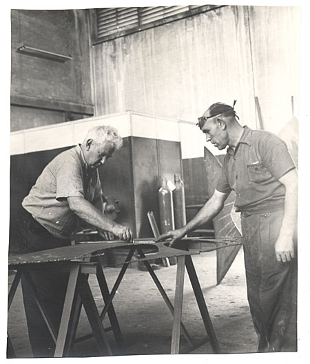 Alexander Calder and assistant lay out sculpture.