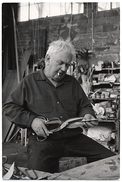 Alexander Calder cutting metal