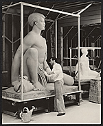 Brents Carlton doing finishing work on his sculpture Polynesian boy