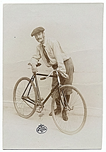 Lyonel Feininger standing with a bicycle