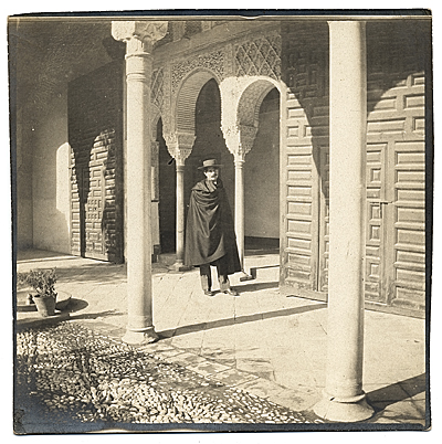 [Eliot Clark in a cape at La alhambra, Granada, Spain.]