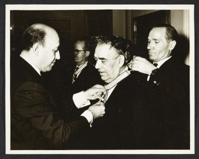 George Constant receiving a medal