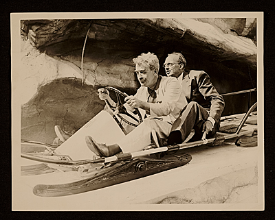 [James Montgomery Flagg and Dean Cornwell sitting on a sled]
