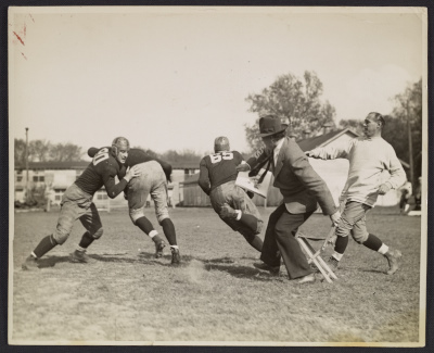[John Steuart Curry sketching a football practice at the University of Wisconsin-Madison]