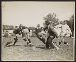 [John Steuart Curry sketching a football practice at the University of Wisconsin-Madison ]