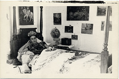 Frida Kahlo reclining on her bed in Coyoacán, Mexico