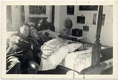 [Frida Kahlo and Diego Rivera reclining, Coyoacán, Mexico]
