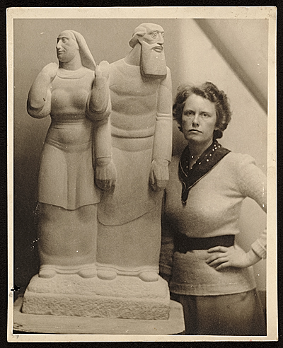 Janet De Coux with her sculpture Sarah and Abraham